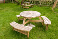 Wooden table with benches close up of the in the garden Royalty Free Stock Photography