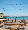 Wooden table and box in outdoor restaurant background is landsc at landscape of boat the sea pattaya city shooting from koh lan Stock Photo