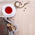 Wooden table for breakfast with cup of tea biscuits and watch Royalty Free Stock Images