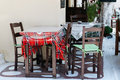 Wooden table with chairs at traditional Greek cafe Royalty Free Stock Photo