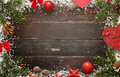 Wooden table with christmas decorations. Top view of board with free space for greeting text Royalty Free Stock Photo
