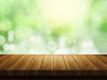 Wooden table with defocussed background Royalty Free Stock Photo