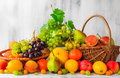 Wooden table full fresh fruit baskets Royalty Free Stock Photo