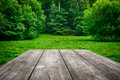 Wooden table with green nature background picnic Royalty Free Stock Photography
