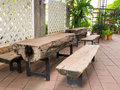 Wooden table with legs made of steel, is large. Royalty Free Stock Photo