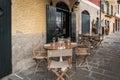 Wooden table near traditional Italian cafe in Portofino town, Italy