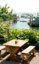 Wooden table with sea port view in summer Stock Photo
