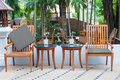 Wooden table set in garden a setting Royalty Free Stock Photos
