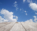 Wooden table top on blue sky with cloud Royalty Free Stock Photo