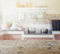 Wooden table top with blur of modern kitchen interior Royalty Free Stock Photo