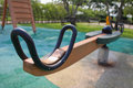 Wooden teeter totter Royalty Free Stock Images