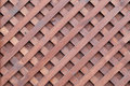 Wooden texture the of the brown surface with a grid of thin strips Stock Photography