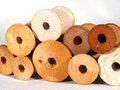 Wooden thread spools antique plain on a white background Stock Image