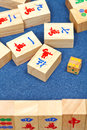 Wooden tiles in mahjong game on blue cloth table Royalty Free Stock Photography