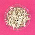 Wooden toothpicks dish pink background a top view of a full of on a Stock Images