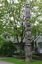 Wooden Totem Pole In Front Of ...