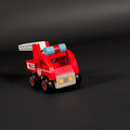 Wooden toy car fire truck in red with white ladder Stock Image