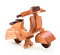 A wooden toy motorcycle isolated o white background Stock Image