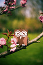 Wooden toy owl in the tree Royalty Free Stock Photos