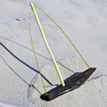 Wooden toy-ship with a mast on sandy waves. Stock Image