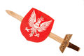 Wooden toy sword and shield a coat of arms of poland with isolated over white Stock Images