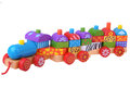 Wooden toy train with colorful blocks Royalty Free Stock Photo