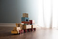 Wooden toy train on the floor Royalty Free Stock Photo