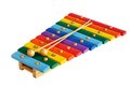 Wooden toy xylophone rainbow colored against white background Royalty Free Stock Photos