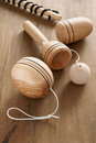 Wooden toys old fashioned yo yo cup and ball and a top and whip a retro childhood concept Royalty Free Stock Photos