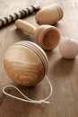 Wooden toys old fashioned yo yo cup and ball and a top and whip a retro childhood concept Royalty Free Stock Photo