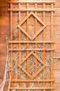 Wooden trellis on wood wall Royalty Free Stock Photo