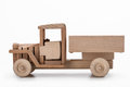 Wooden truck side view on white background.
