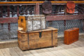 Wooden trunks old vintage railway luggage suitcase are on the platform Stock Photos