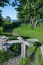 Wooden turnstile old at a pathway to the coast of baltic sea from the island oland in sweden Stock Photo