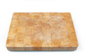 Wooden used cutting board on white background Royalty Free Stock Photos