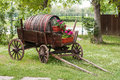 Wooden wagon old with old keg in a garden Stock Photo