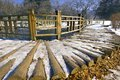 The wooden walkpath path of a bridge covered with snow at nami island south korea during winter Royalty Free Stock Image