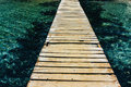 Wooden walkway above the turquoise sea Stock Photos