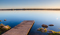 Wooden walkway leading into the water Stock Images