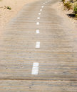 Wooden walkway with marking pattern Royalty Free Stock Photo