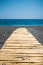 Wooden walkway to the aegean sea traditional at a very peaceful beach of crete greece Stock Images