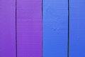 Wooden wall colourful fence painted in purple and blue colours Stock Photography