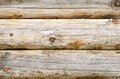 Wooden wall of a loghouse as a background Royalty Free Stock Photo
