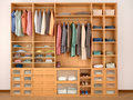 Wooden wardrobe closet full of different things. Royalty Free Stock Photo