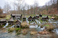 Wooden water mills built on a fast floting river Royalty Free Stock Photo