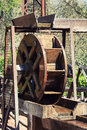 Wooden watermill powered by running water Stock Photos