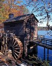 Wooden waterwheel atlanta usa and lake to rear during the fall stone mountain georgia Royalty Free Stock Image