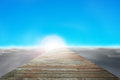 Wooden way direct to sun with cloudy below and blue sky clear Stock Photo