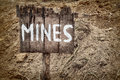 Wooden weathered warning sign for mines Royalty Free Stock Photo