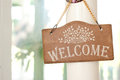 Wooden welcome sign on the door for restaurant for all guesses Stock Images
